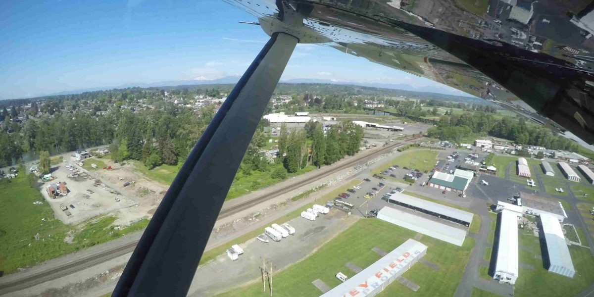 Area shot of the skydive snohomish airport surrounded by green grass.