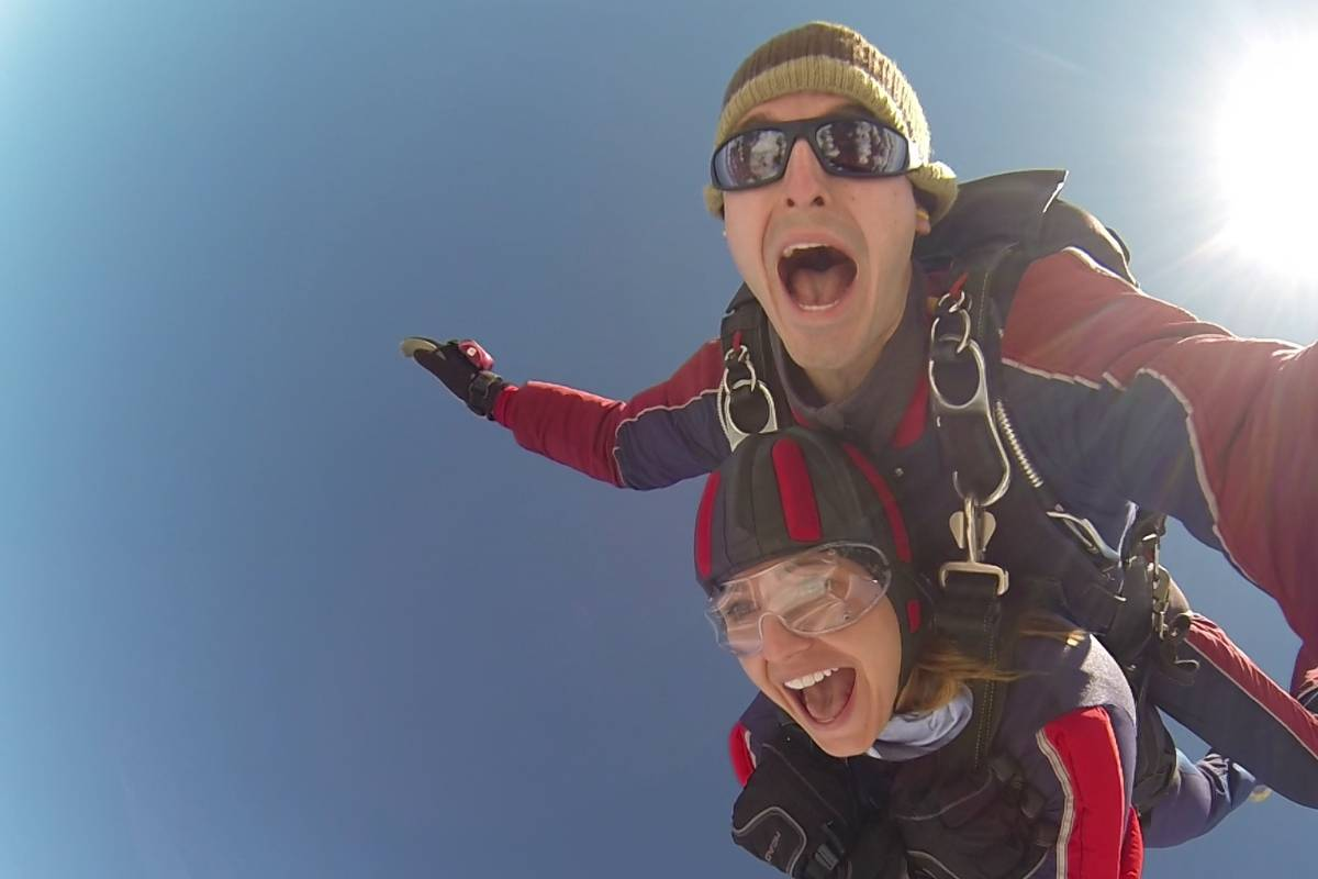 woman in freefall opens her mouth wide with excitement