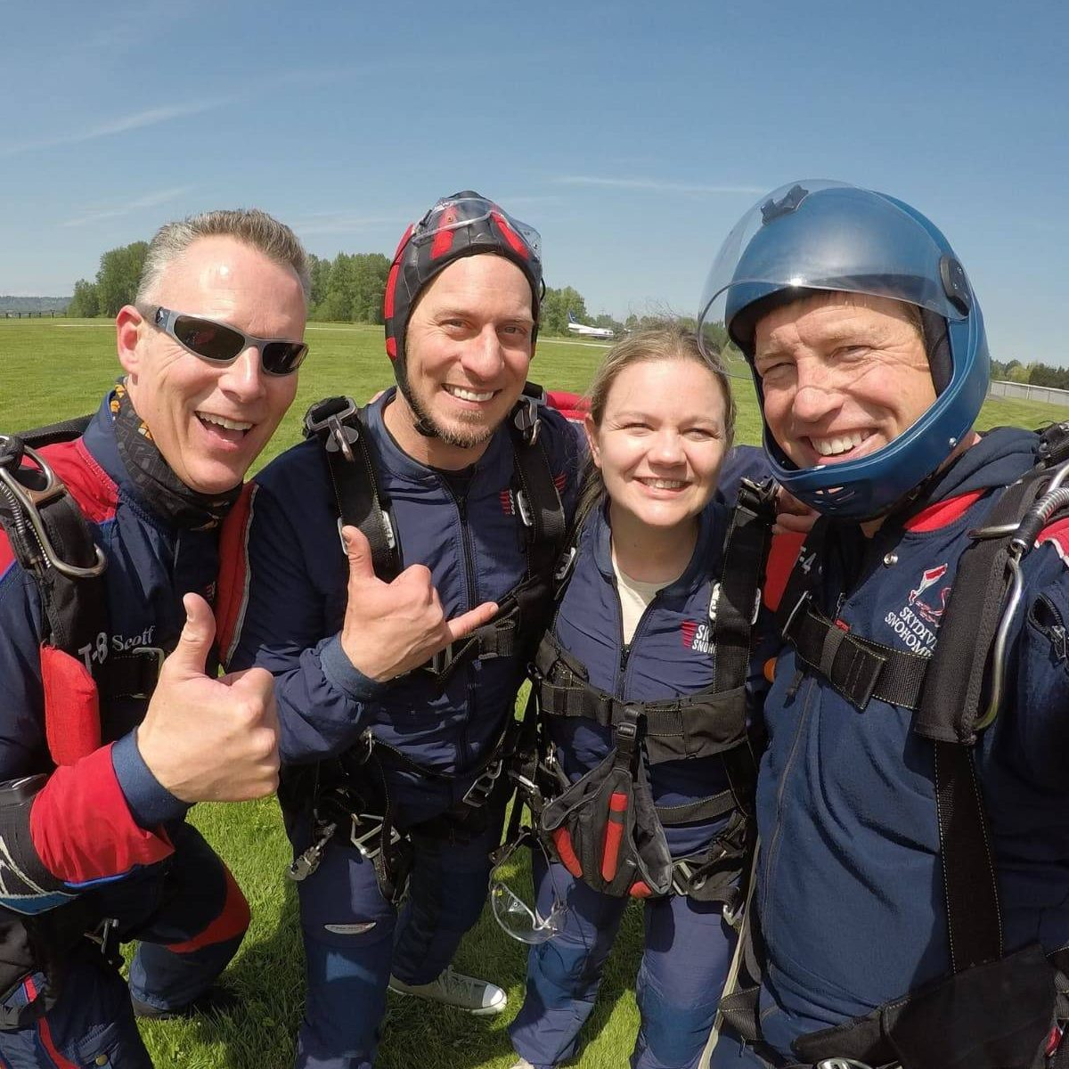 Tandem instructors smiling at Skydive Snohomish landing area.