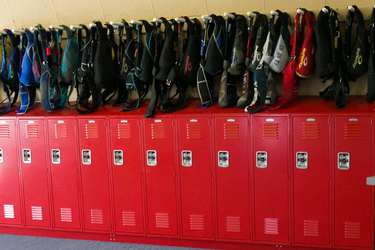 rigs hang neatly over red lockers