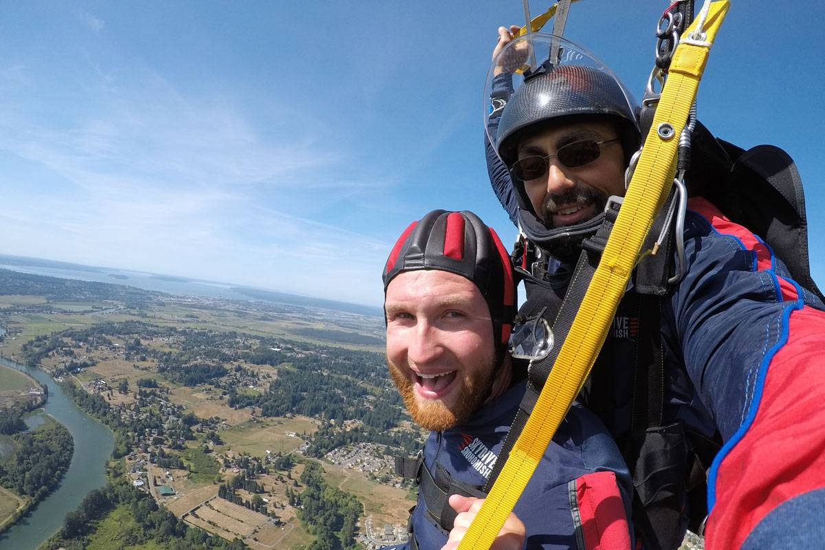 Instructor and student smiling while under canopy
